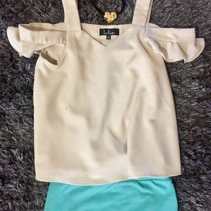 Cold shoulder blouse by Lulu's